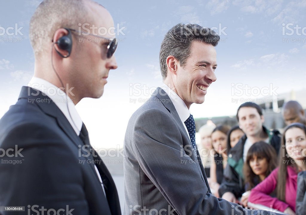 Politician shaking hands on campaign trail stock photo