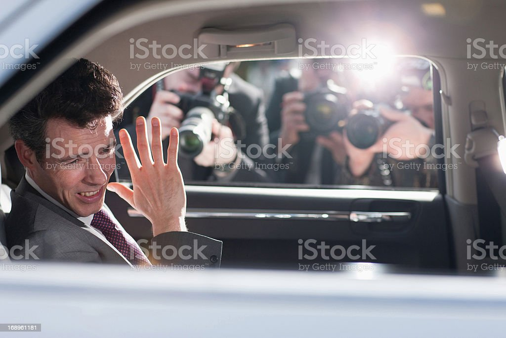 Politician shielding himself from paparazzi royalty-free stock photo