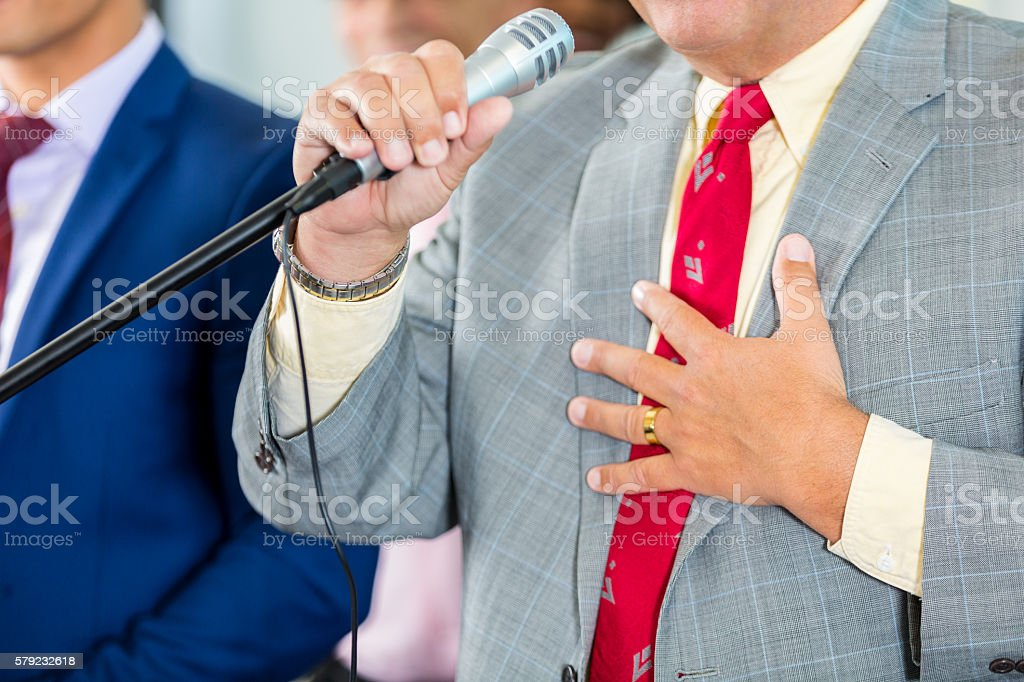 Politician speaking into midrophone stock photo