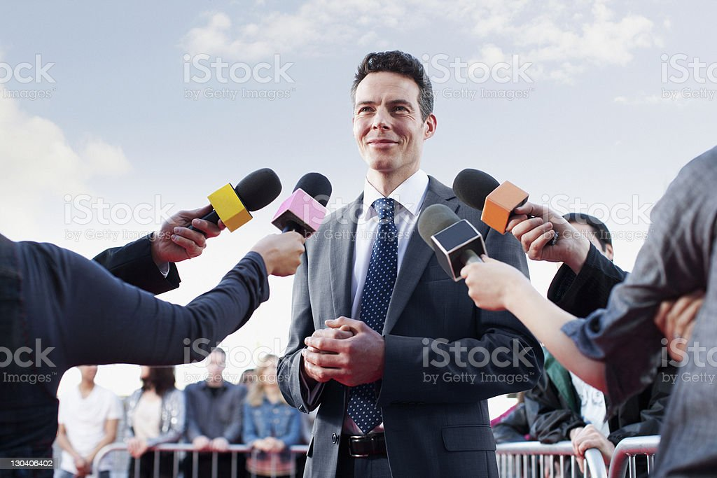 Politician speaking to reporters stock photo
