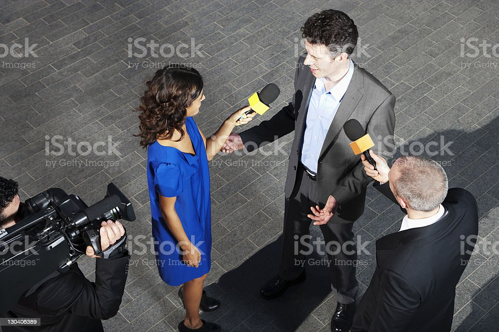 Politician talking to reporters royalty-free stock photo