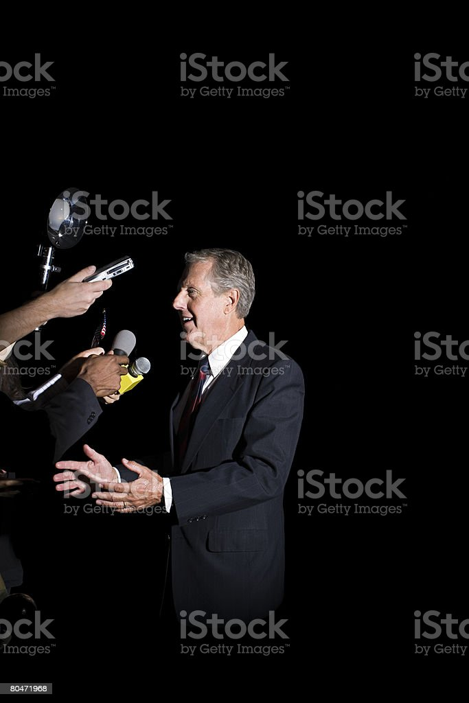 A politician talking to reporters stock photo