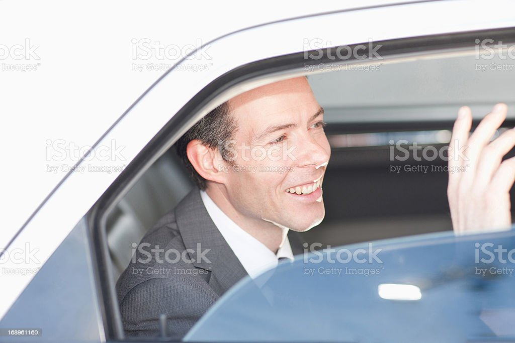 Politician waving from backseat of car royalty-free stock photo