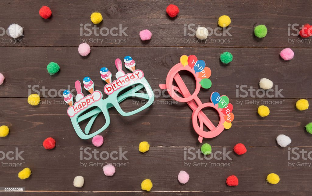 Polka dot background and glasses on the wood stock photo