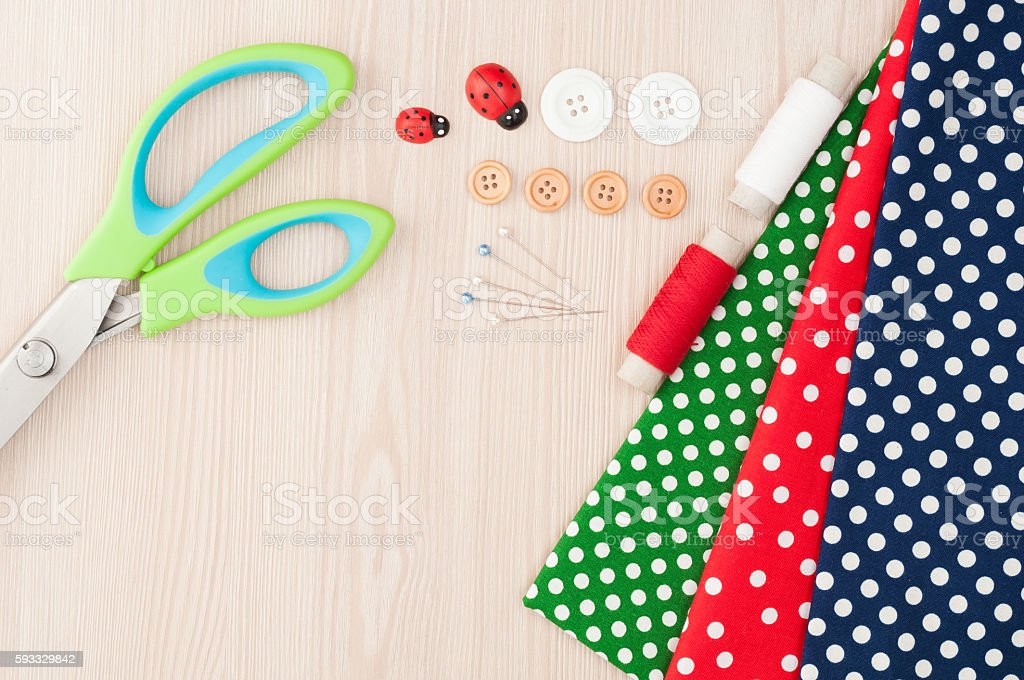 Polka dot fabric for sewing and accessories for needlework. Spoo stock photo