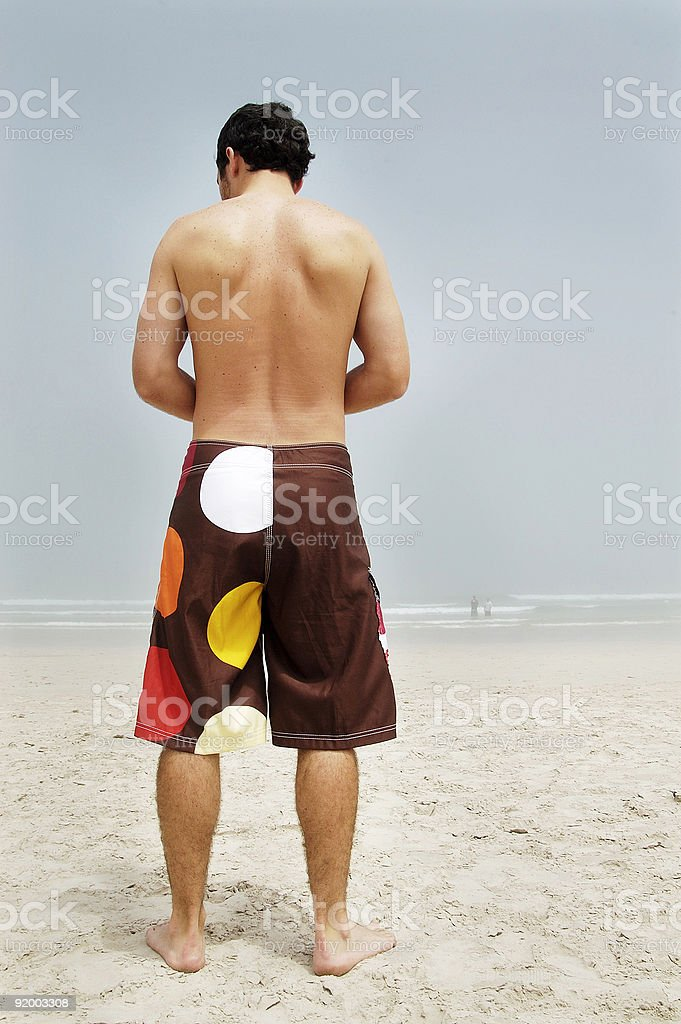 Polka dot guy on beach stock photo