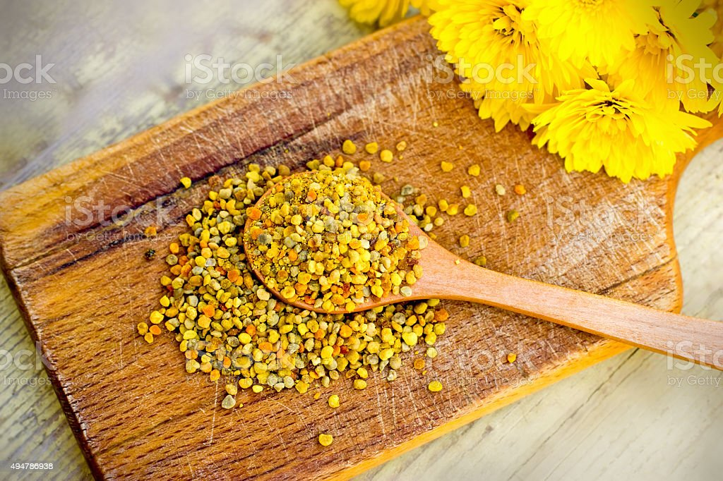 Pollen - pollen granules in wooden spoon stock photo