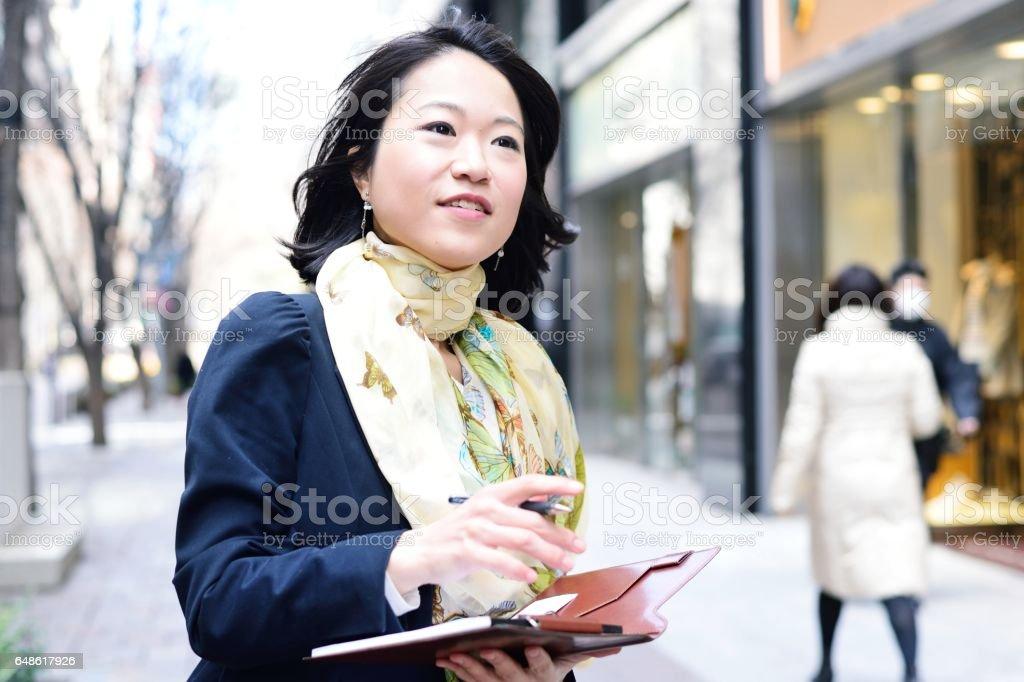 Pollster in city street stock photo