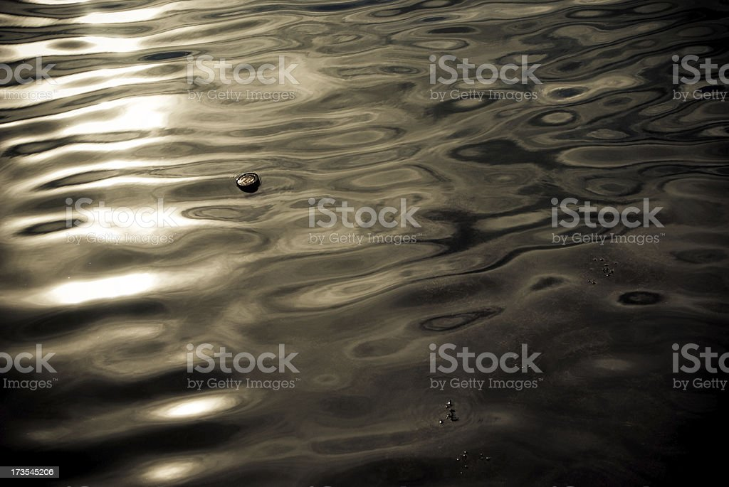 Polluted river background with floating rubbish royalty-free stock photo