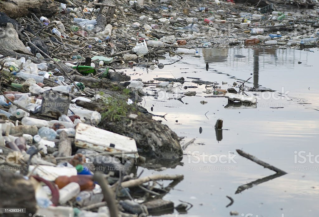 Polluted river bank stock photo