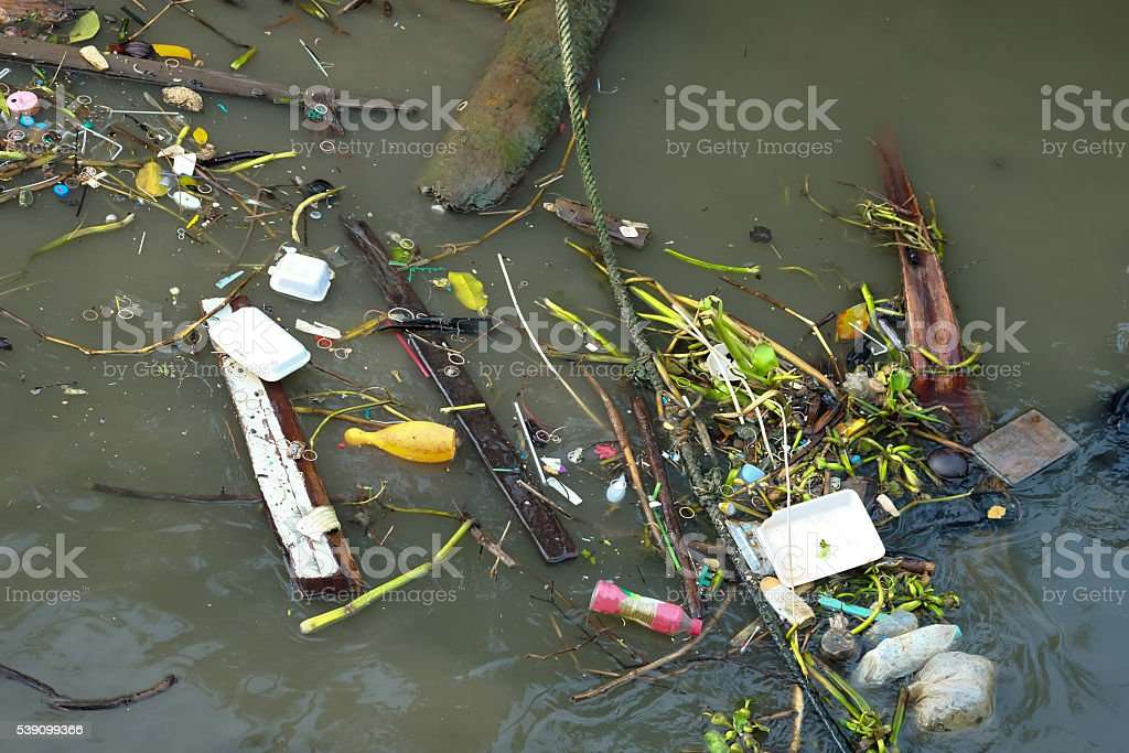 Polluted river with various garbage and trash stock photo