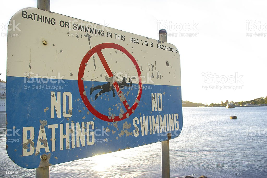 polluted waters:no bathing or swimming sign royalty-free stock photo