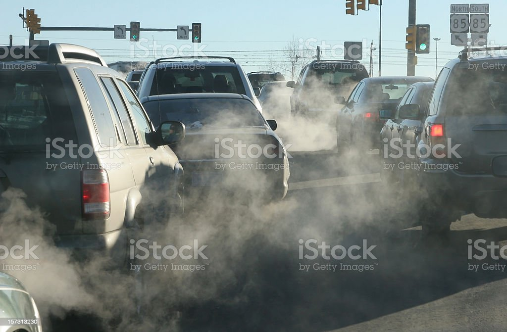 Polluting clouds of exhaust fumes rise in the air stock photo