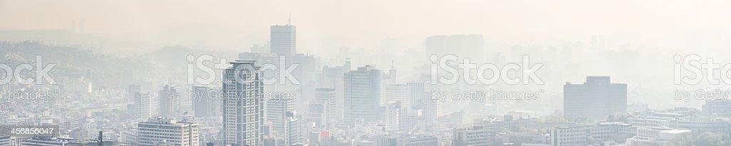 Pollution and smog shrouding skyscraper crowded cityscape panorama Seoul Korea stock photo
