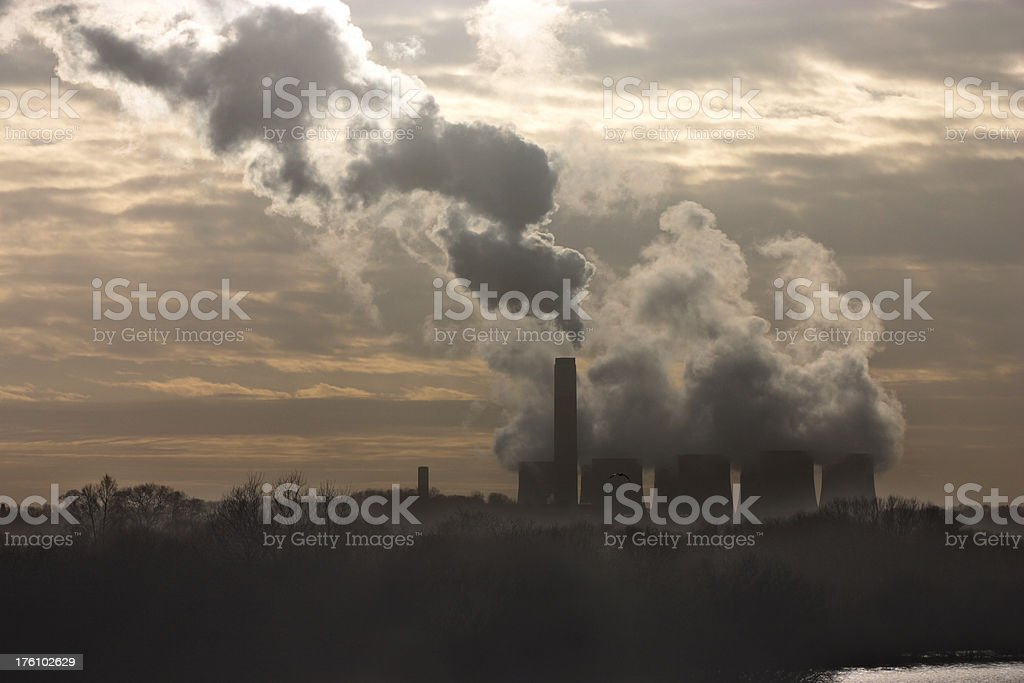 Pollution and steam from coal-fired power station royalty-free stock photo