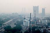 Pollution in Noida Delhi against the cityscape