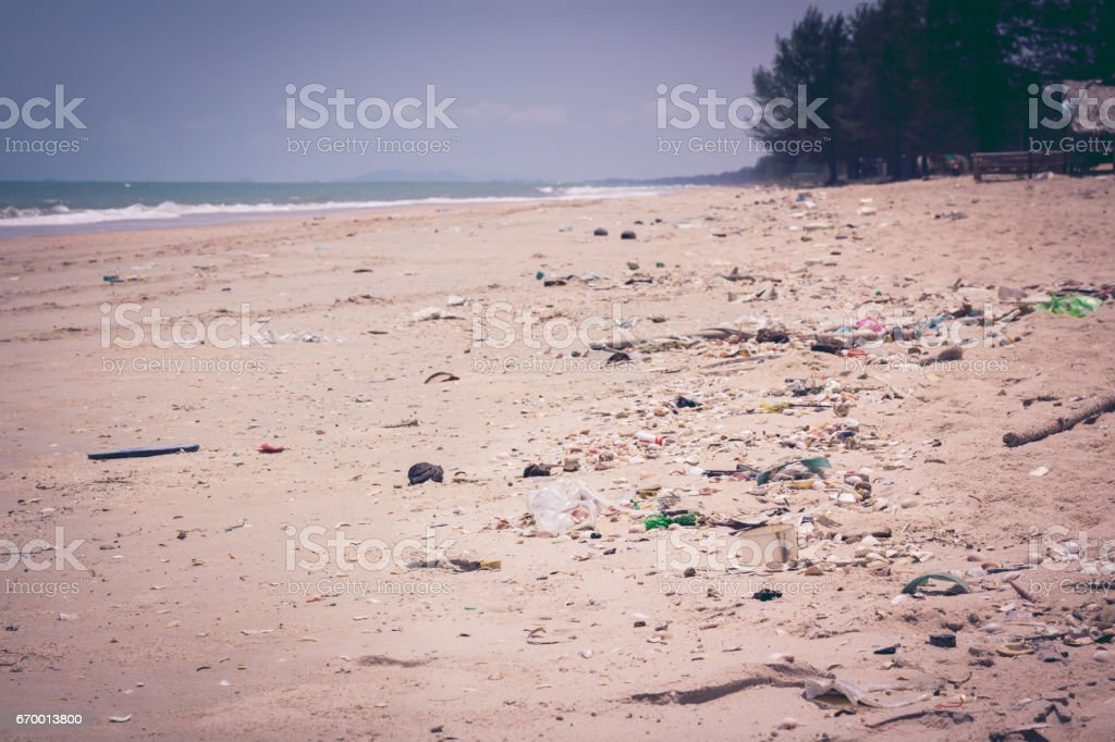 Pollution on beach of tropical sea. Outdoors. Vintage tone effect. stock photo