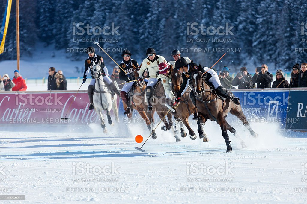 Polo Players Chase Ball stock photo