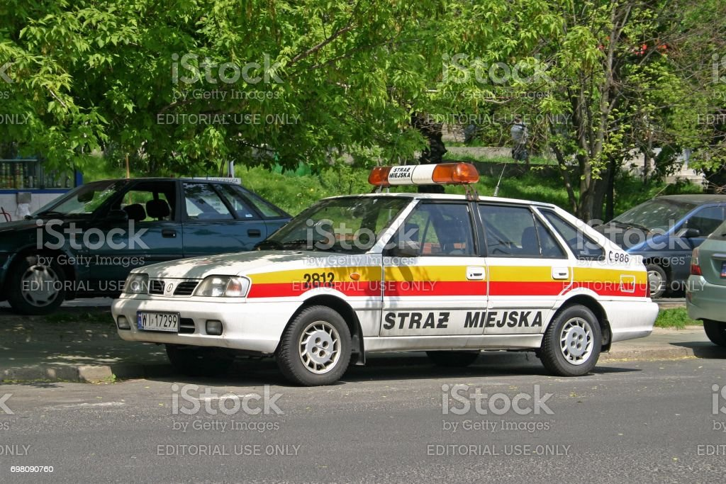 FSO Polonez municipal police car on the street stock photo