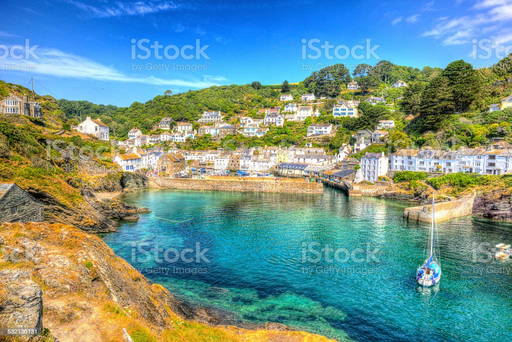 Polperro harbour Cornwall England turquoise sea in vivid colour HDR stock photo
