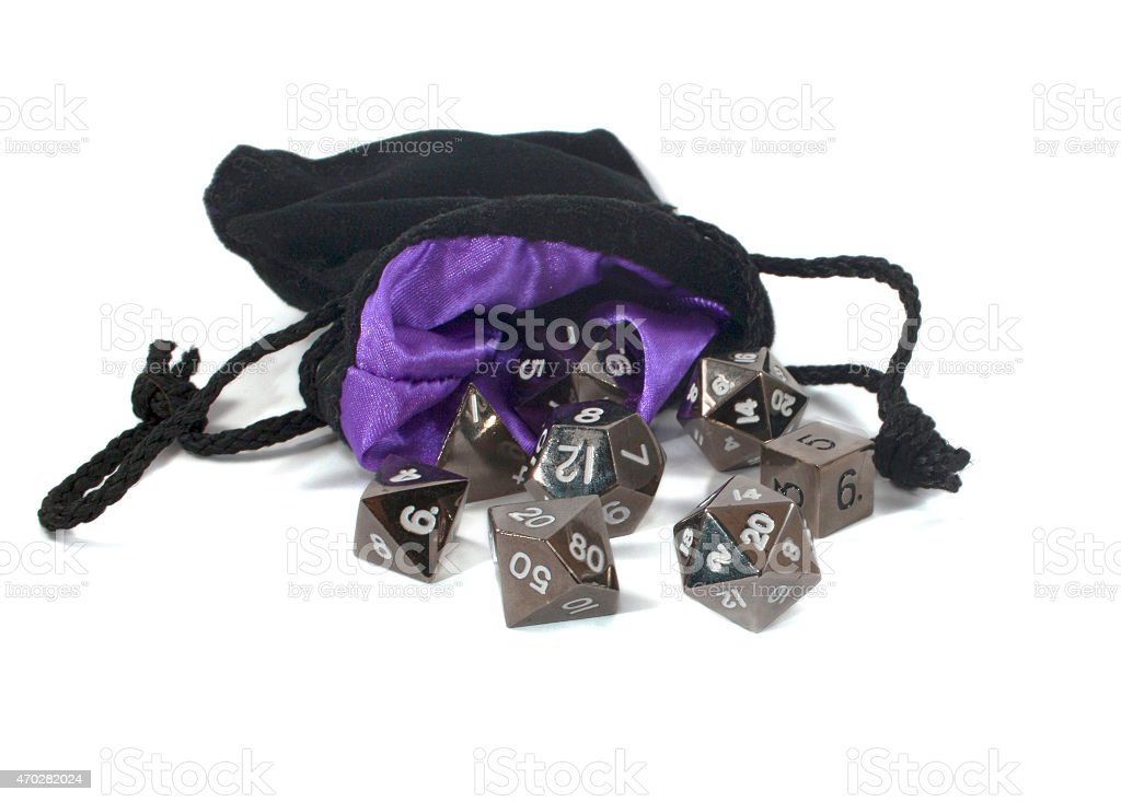 Polyhedral dice in a bag. stock photo