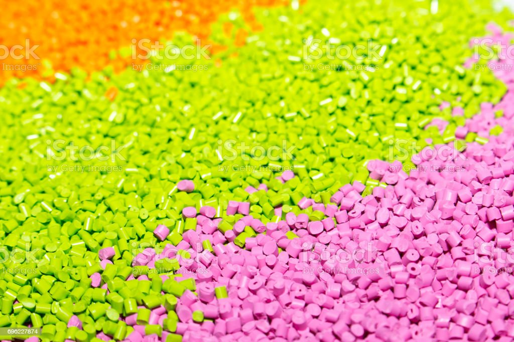 Polymeric dye for plastics. Pigment in the granules. Plastic granules stock photo