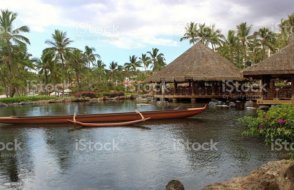 Polynesian Canoe and Tiki Hut royalty-free stock photo