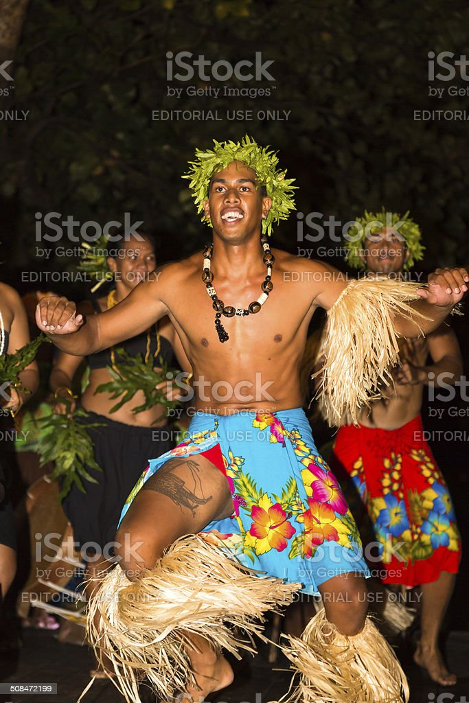 Polynesian dancers performing traditional dance during night show. stock photo