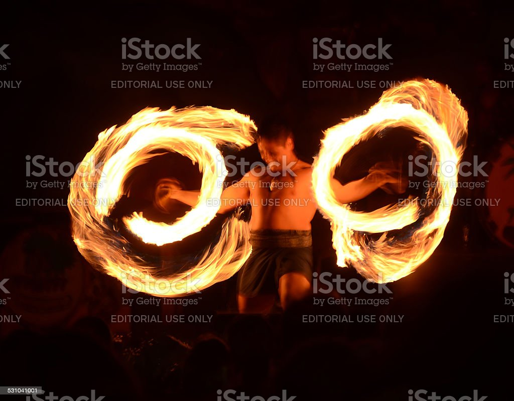 Polynesian fire dancer stock photo