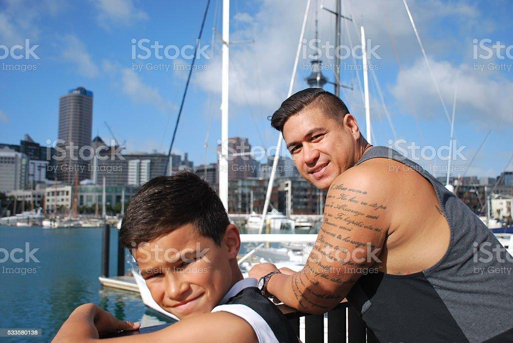 Polynesian Man and Boy by Coastal Marina stock photo