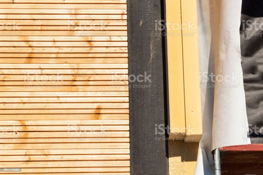 Polystyrene insulation of wood buildings. Eco-friendly building insulation. stock photo