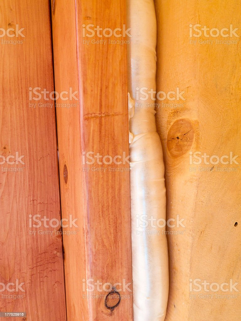 Polyurethane foam seals gap in wood construction royalty-free stock photo