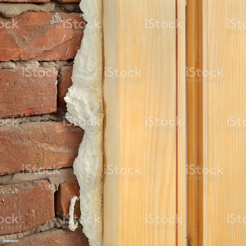 Polyurethane for door or window install stock photo
