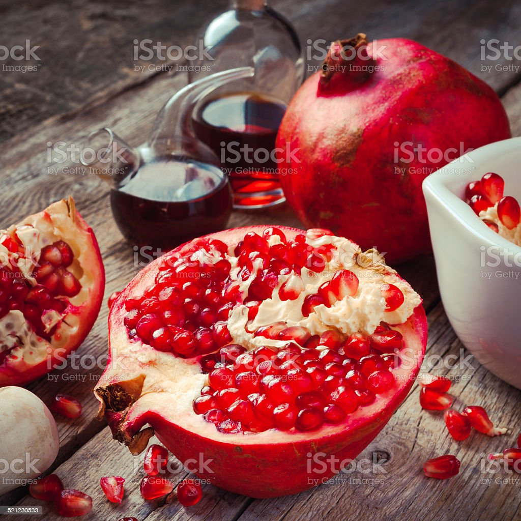 Pomegranate and bottles of essence or tincture stock photo
