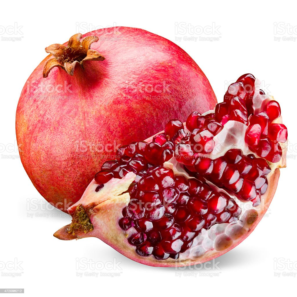 Pomegranate and its piece isolated on a white background. stock photo