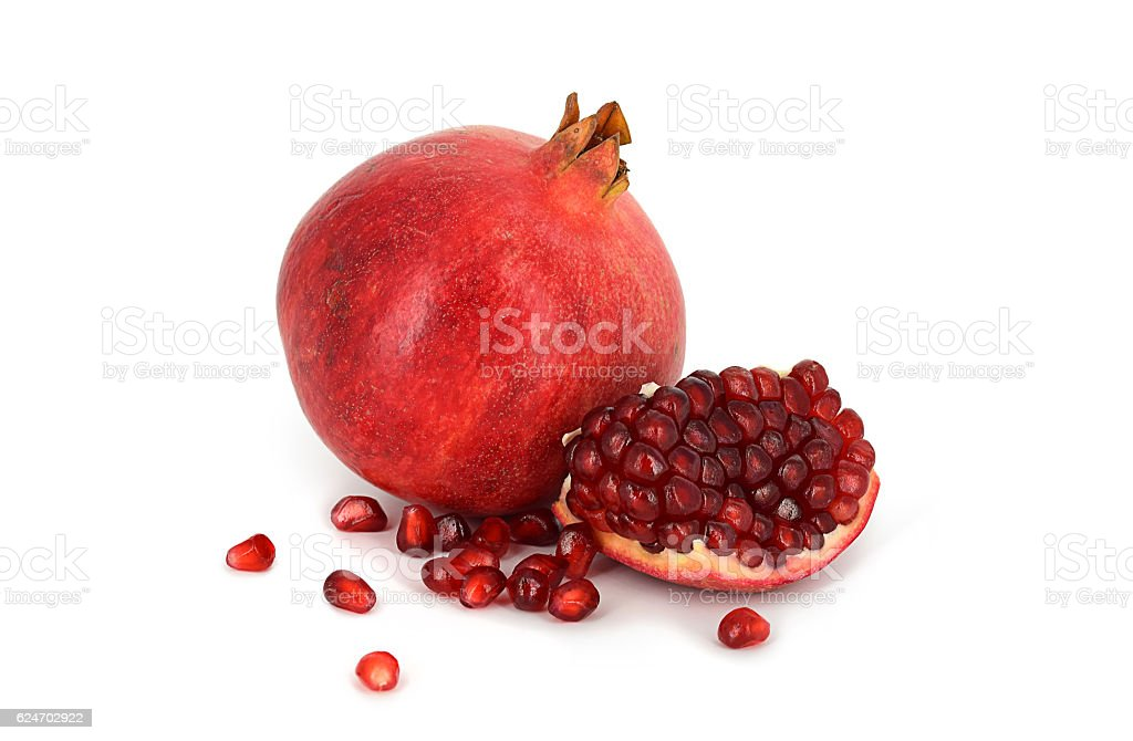 Pomegranate and its piece isolated on a white background stock photo