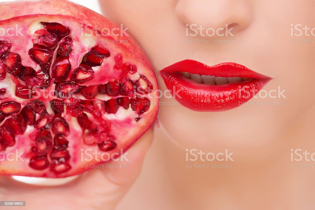 pomegranate and red lips stock photo