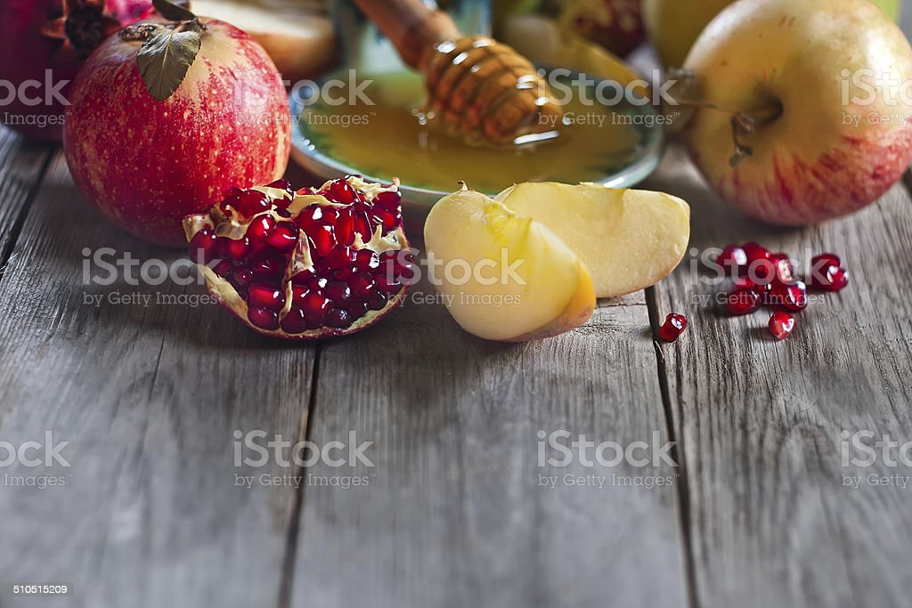 Pomegranate, apples and honey background stock photo