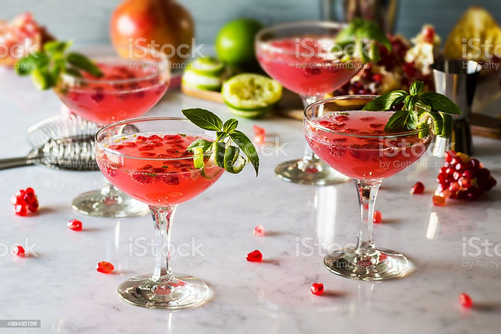 Pomegranate Basil Martinis or Gin Smash Cocktails stock photo