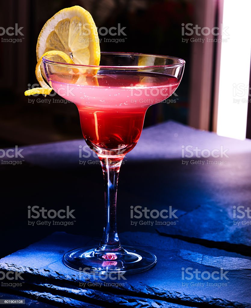Pomegranate cocktail on black background stock photo