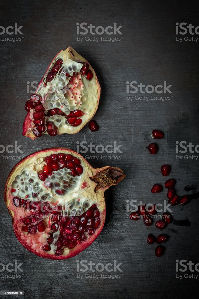 Pomegranate core on black background, top view stock photo