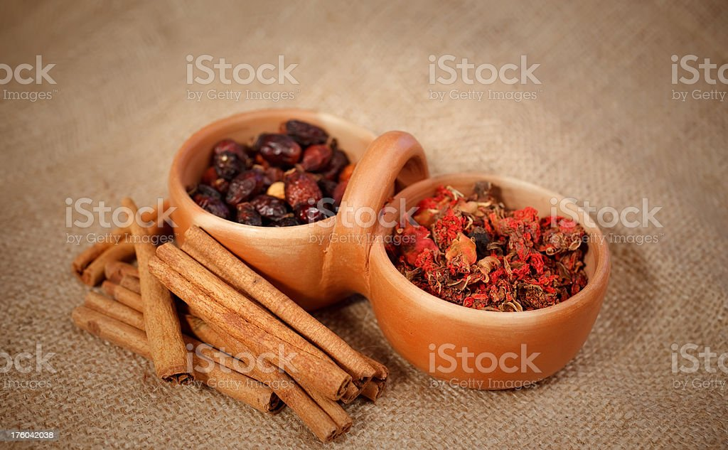 Pomegranate flowers, cinnamon and rosehips stock photo
