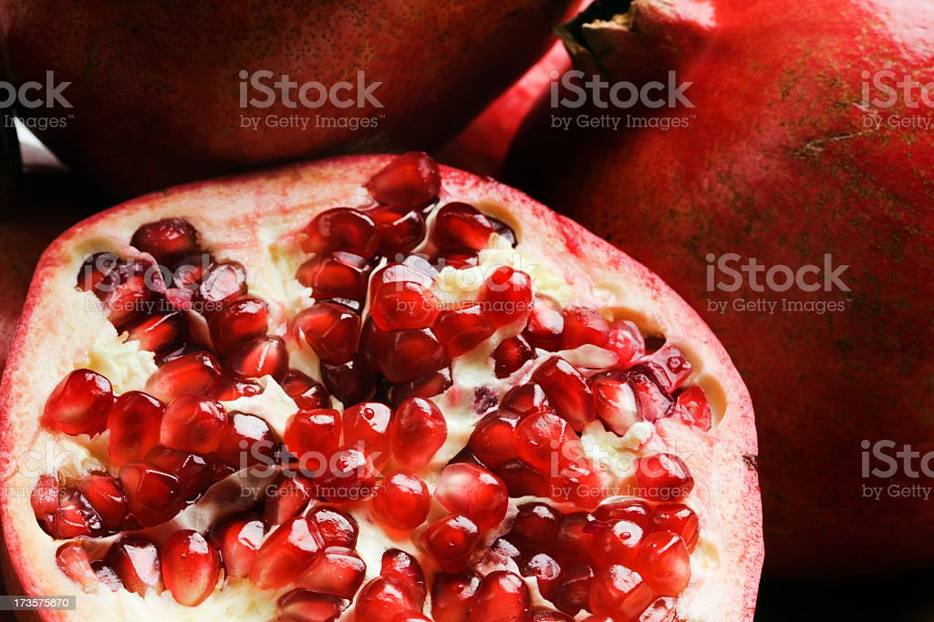 Pomegranate, Fresh Tropical Fruit Food Cut Open in Half Close-up royalty-free stock photo