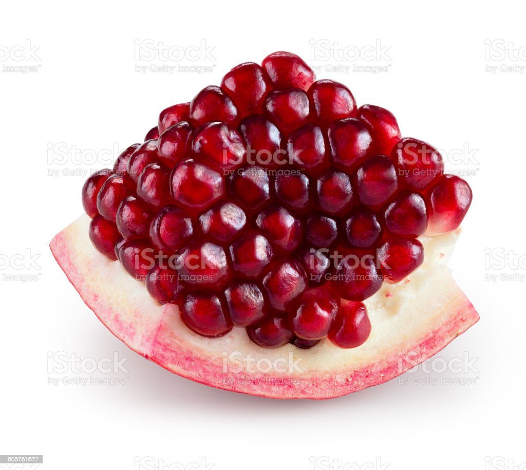 Pomegranate. Fruit segment isolated on white. With clipping path. stock photo