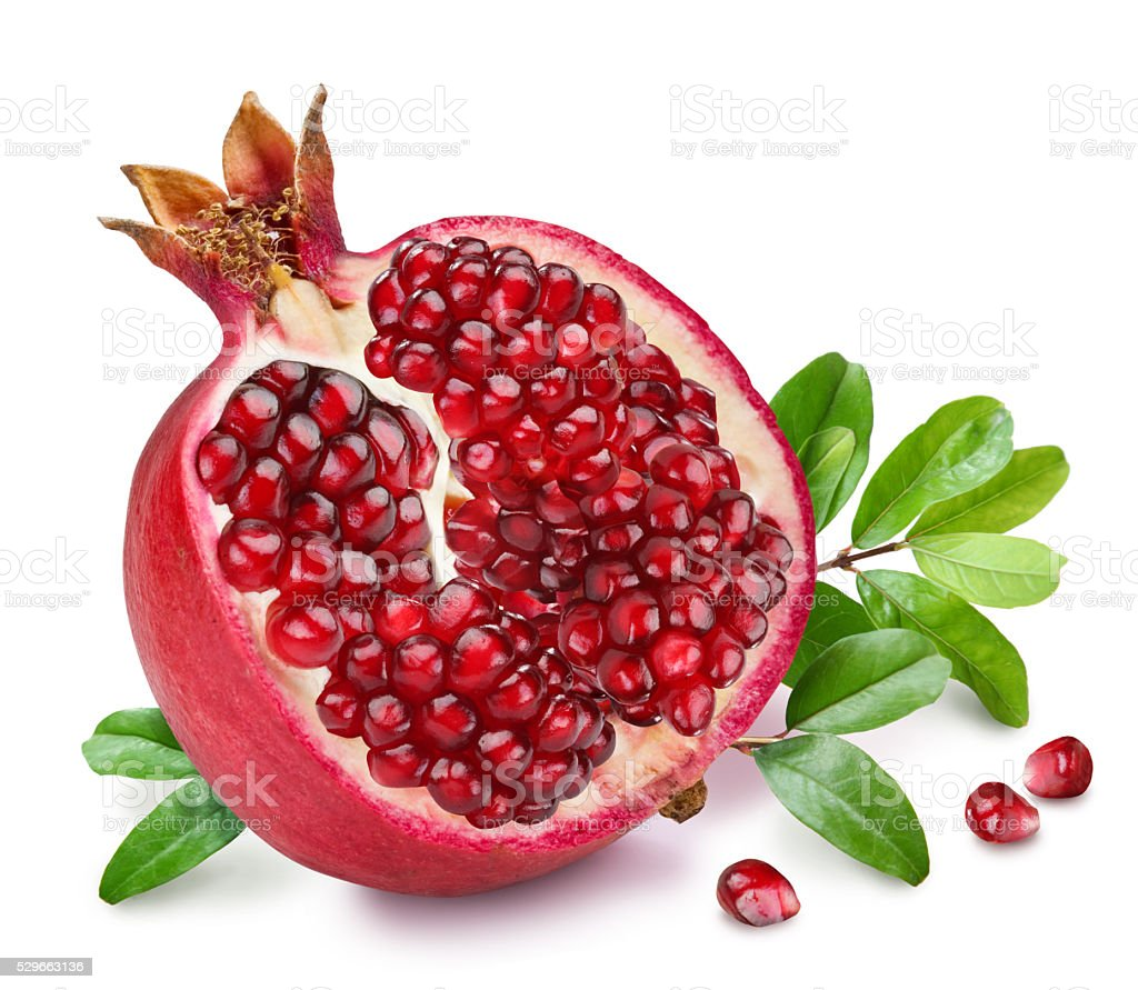 Pomegranate fruit with green leaves. stock photo