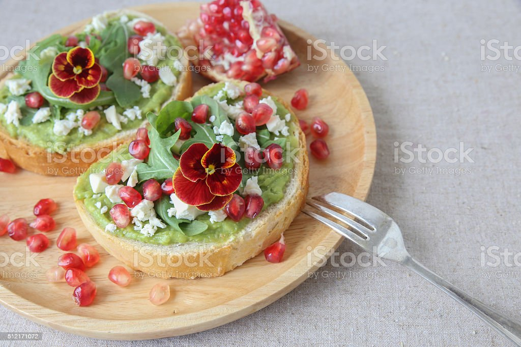 Pomegranate green sourdough open face sandwiches toast stock photo