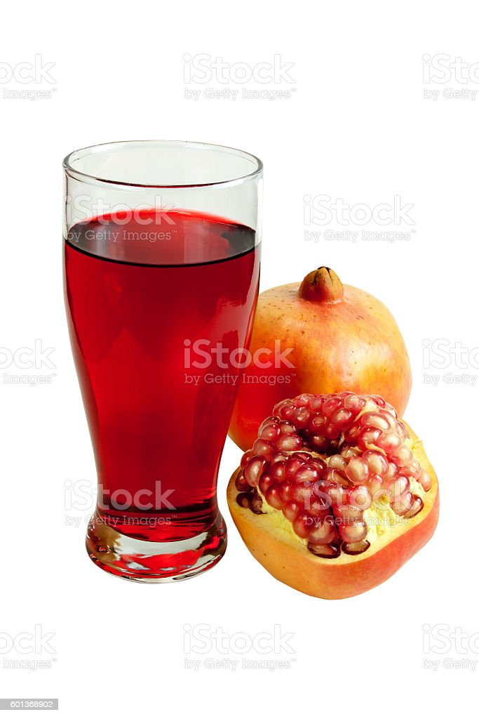 pomegranate juice in a glass stock photo