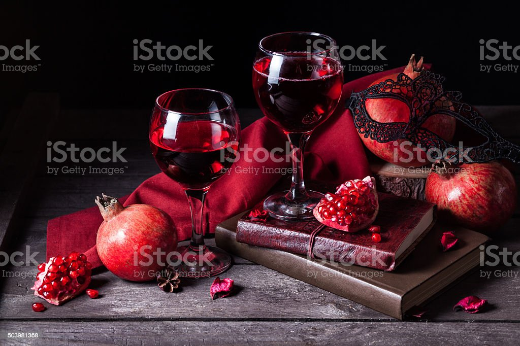 Pomegranate juice in wine glasses stock photo
