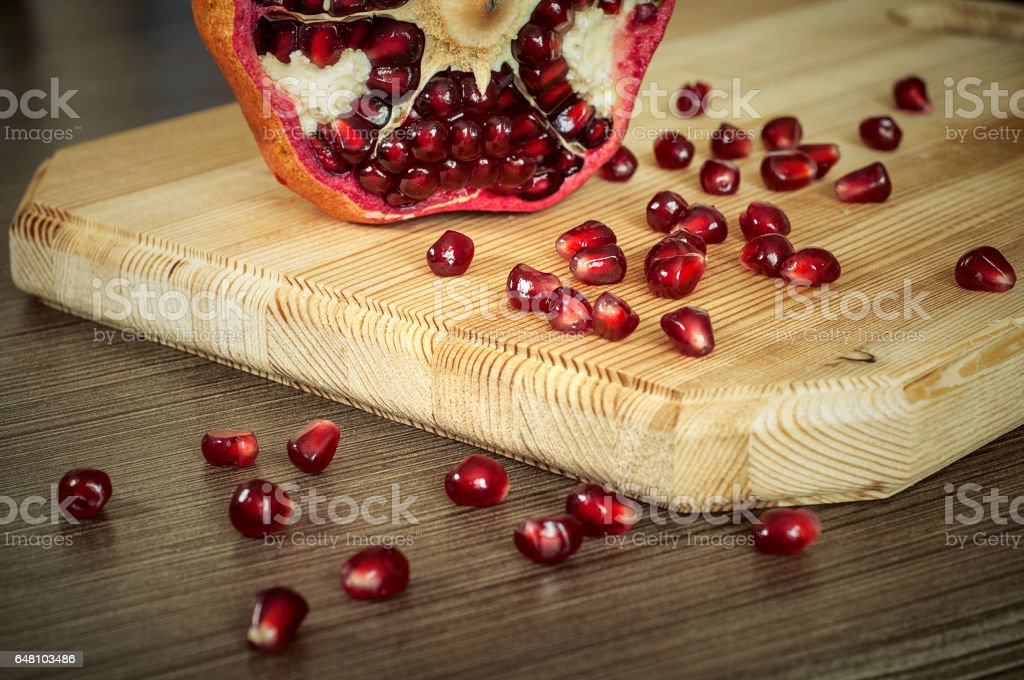 Pomegranate on a cutting Board stock photo