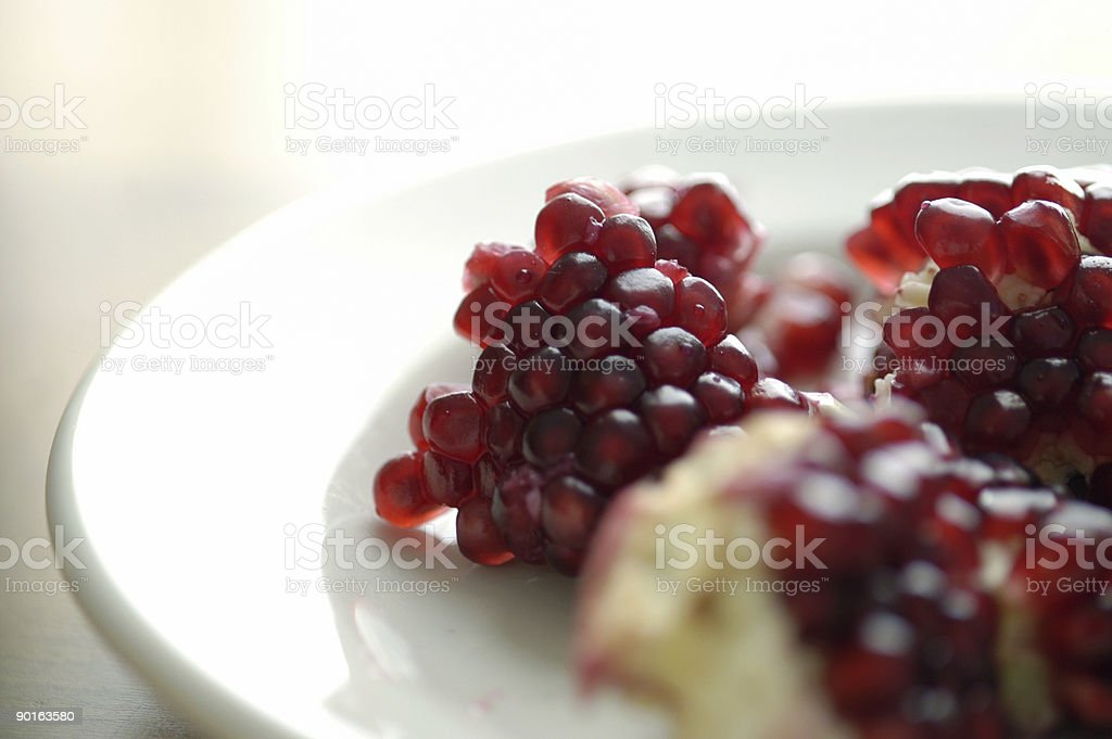 Pomegranate on plate stock photo